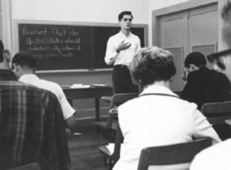 Former UT debater and current U.S. Congressman Lloyd Doggett practices with other members of the debate team in 1966.
